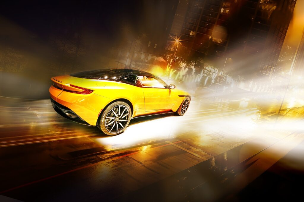 Image of a yellow sports car driving fast